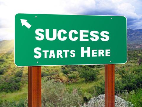 signboard saying success starts here